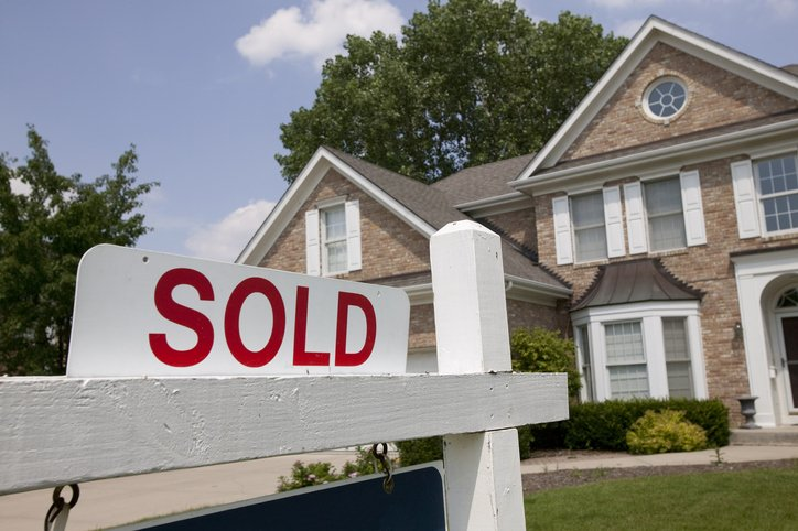 """""""sold"""" sign in front of house"""